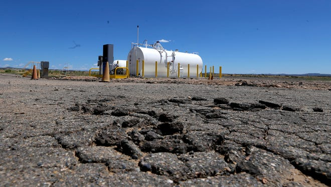 Cracked asphalt is pictured on Wednesday near the fueling station at the Aztec Municipal Airport. The airport is among 11 in the state that will receive federal funding to make improvements and repairs.
