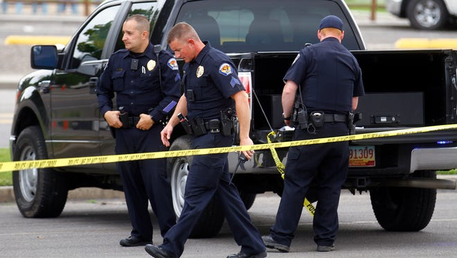 Farmington police officers set up a staging area on Friday at the Animas Valley Mall in Farmington.