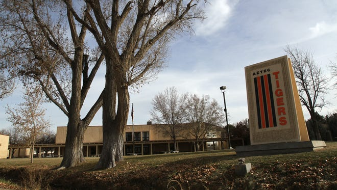 An Aztec High School secretary told a student to encourage his classmates to attend a court hearing to support a drama teacher accused earlier this year of child sexual abuse, according to text messages obtained by The Daily Times.