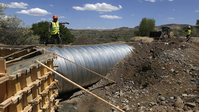 Rudy Shorty, a construction worker with Aztec Well Servicing, works on a culvert on May 23 at the Bloomfield Irrigation Ditch in Blanco.
