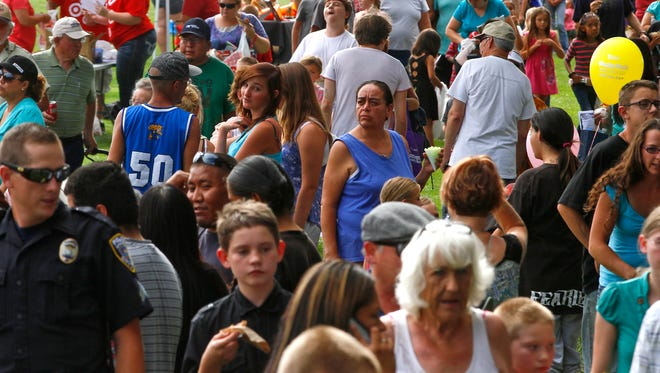 Aztec residents gather July 28 at Minium Park for the city of Aztec's annual National Night Out event.