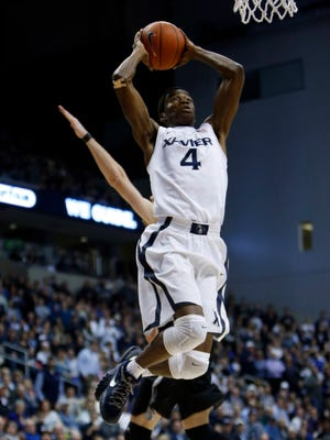 Xavier Musketeers guard Edmond Sumner (4) shoots during the second half against the Providence Friars at the Cintas Center. Xavier won 85-74.