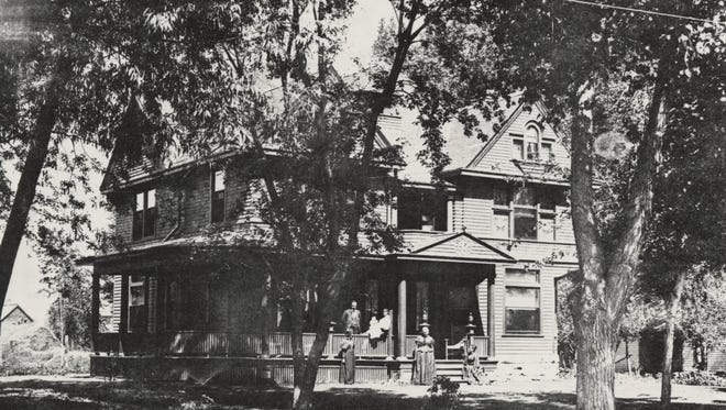 The Boughton family stands outside of their 113 N. Sherwood St. home in Fort Collins around 1895. Judge Jay Boughton is pictured on the porch. His wife, Celestia, is standing at the center.