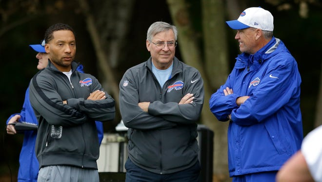 Buffalo Bills head coach Rex Ryan, right, talks with team owner Terry Pegula, center, and team manager Doug Whaley during an NFL training session in England where the Bills lost to Jacksonville, a key setback in their 8-8 season. Pegula put rumors either Whaley or Ryan would be fired with a public statement of support.