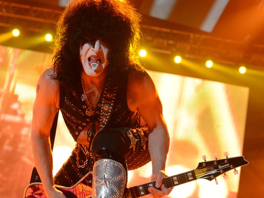 Paul Stanley of KISS flashes a guitar pick on his tongue during the band's concert Wednesday at the Resch Center.