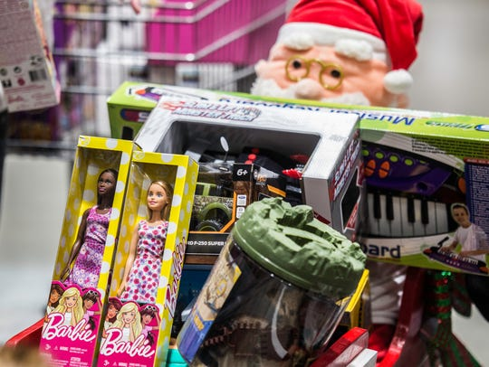 Toys sit in Alvin's sleigh at Menards before they're bought for the Toys for Tots program on Tuesday, Dec. 19, 2017.