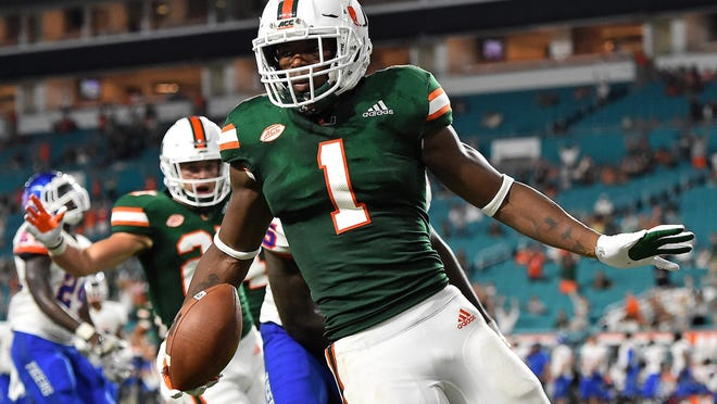 In this 2018 photo, then-Miami running back Lorenzo Lingard celebrates his touchdown against Savannah State. Lingard will be eligible to play for Florida this year, and will be a big addition for their run game.