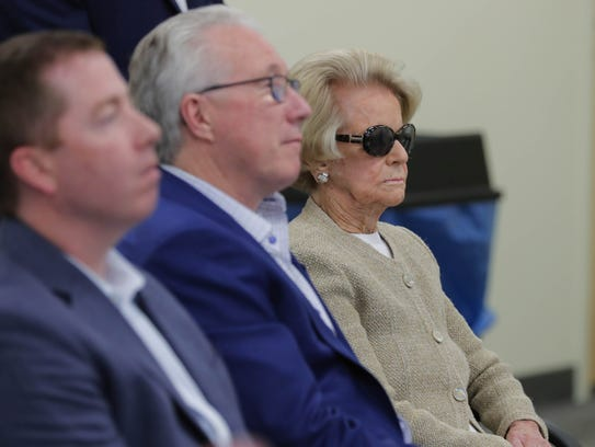 Lions general manager Bob Quinn, president Rod Wood, and owner Martha Firestone Ford listen to head coach Matt Patricia's news conference May 10, 2018 in Allen Park.