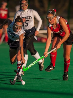 Essex's Hannah Palmer, left, battles with CVU's Maggie Warren during their semifinal game at UVM on Monday, Oct. 30, 2017. CVU pulled out the win, 2-1.
