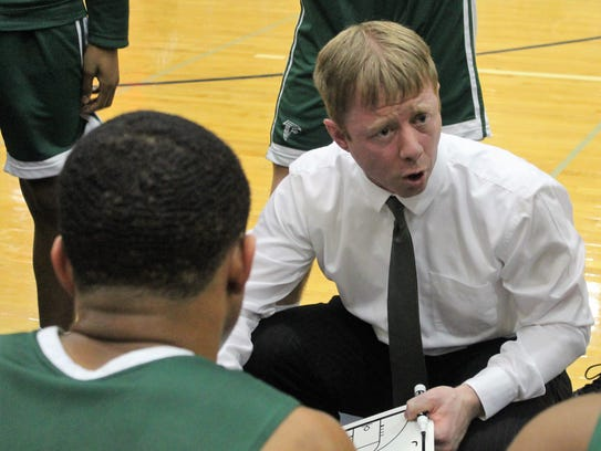 Groves head coach Marc West offers some instruction