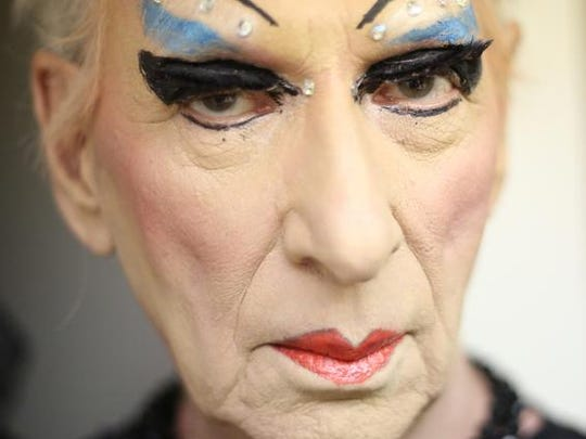 """James """"Gypsy"""" Haake is a veteran performer with a background in theatrical productions. He will be bringing his  performance to the desert. In this photograph Haake puts on makeup for his photo shoot."""