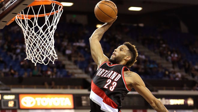 Portland Trail Blazers guard Allen Crabbe goes up to stuff against the Sacramento Kings during the first quarter of an NBA basketball game in Sacramento, Calif., Saturday, Oct. 10, 2015.