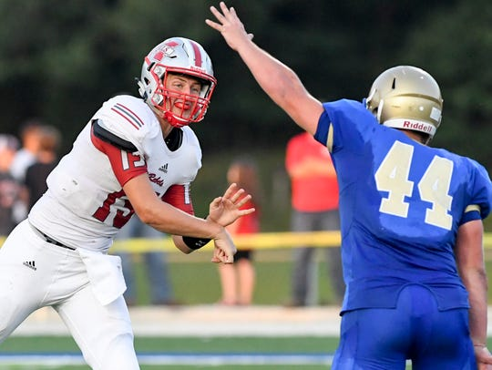 McKenzie's Zach Jarrett makes a pass as Huntingdon's