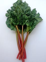 Rhubarb leaves, while pretty, are poisonous; remove