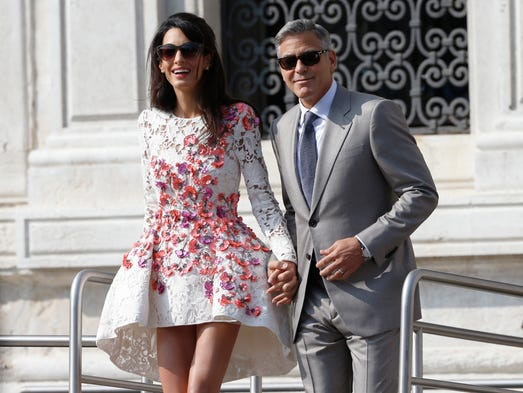 Newlyweds George Clooney and Amal Alamuddin leave the Aman luxury Hotel in Venice the morning after their wedding.