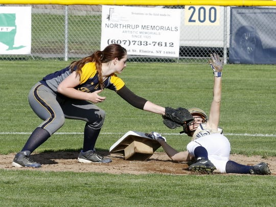 Notre Dame's Maura Glovins asks for a timeout as Tioga shortstop Kurstan Martin goes to apply the tag at second base Friday during the Crusaders' 11-2 victory in Southport.