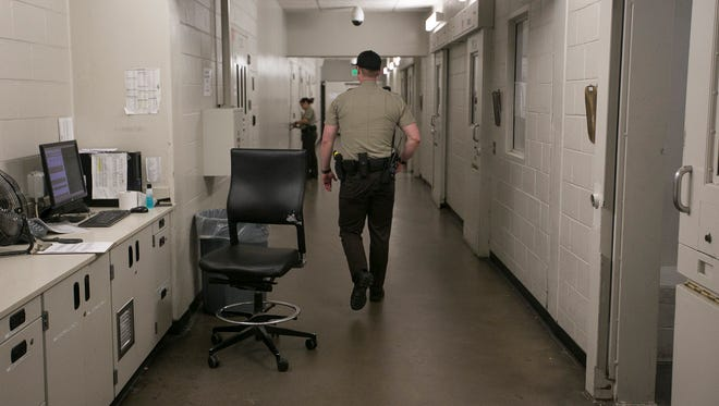 Officers with the Maricopa County Sheriff's Office work inside the 4th Avenue Jail in Phoenix, Ariz. on Feb. 22nd, 2017.