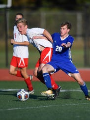 Cardinal Ritter's Colin Hinkle (7) and Memorial's Shawn