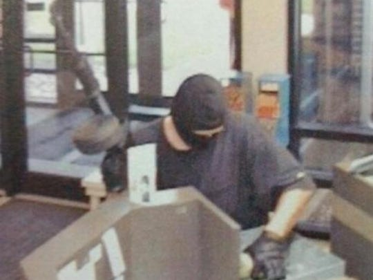 Surveillance footage from Mason City shows the suspect in a bank robbery in 2015.