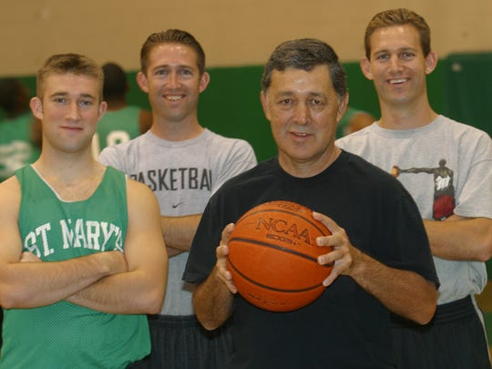 The Lopezes - (L-R) Levi Lopez (son) - Damin Lopez (son) - St. Mary's boys basketball head Coach David Lopez (father) and Eli Lopez (son). Inside St. Mary's gym in Phoenix in a 2002 photo.