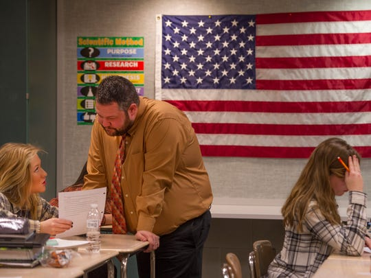 Amelia Bosse, 17, left, has a question clarified by teacher Jeff Johnson in AP Psychology at Central High School.