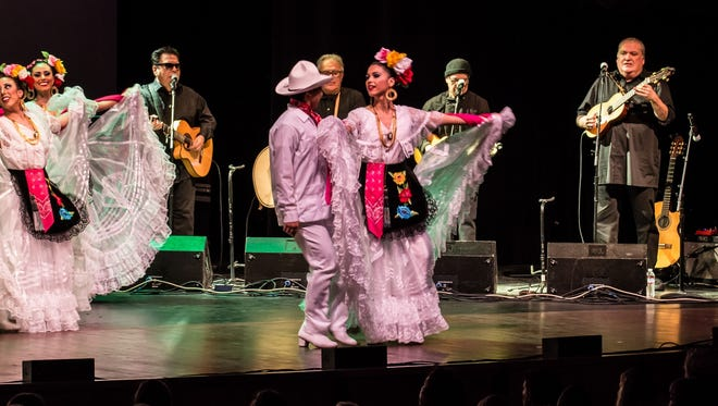 Ballet Folklorico Mexicano with Los Lobos performing in the background.