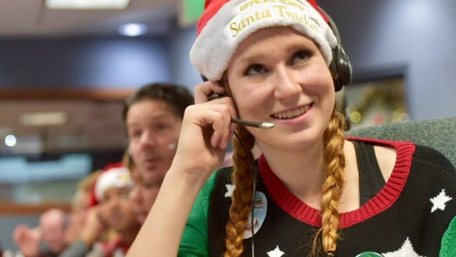 NORAD Tracks Santa volunteer Camille Bazin gives an update on St. Nick's location to a caller on Christmas Eve 2016.