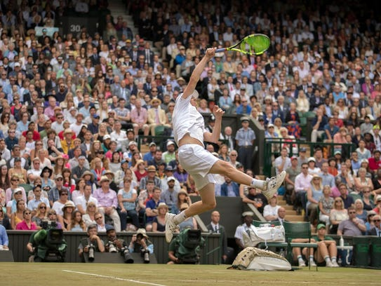 Sam Querrey soars to slam a return in his five-set