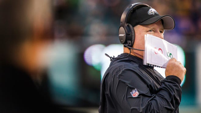 Eagles head coach Chip Kelly looks up at the scoreboard as he talks into his headset in the fourth quarter of the Eagles 45-17 loss to the Tampa Bay Buccaneers in Philadelphia on Nov. 22