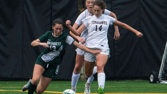 The MIAA will meet on Tuesday to start the process of deciding the safest way to start fall sports during the COVID-19 pandemic so fans may be able to see action like one from a soccer game last season where Wachusett's Sydney McGhee and Algonquin's Jacquelyn Nicoletti battled for control of a ball.