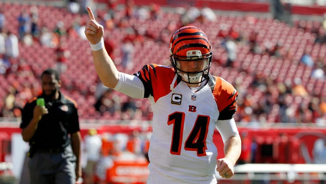 Cincinnati Bengals quarterback Andy Dalton (14) points to the fans as he runs back into the locker room prior to the game against the Tampa Bay Buccaneers at Raymond James Stadium.