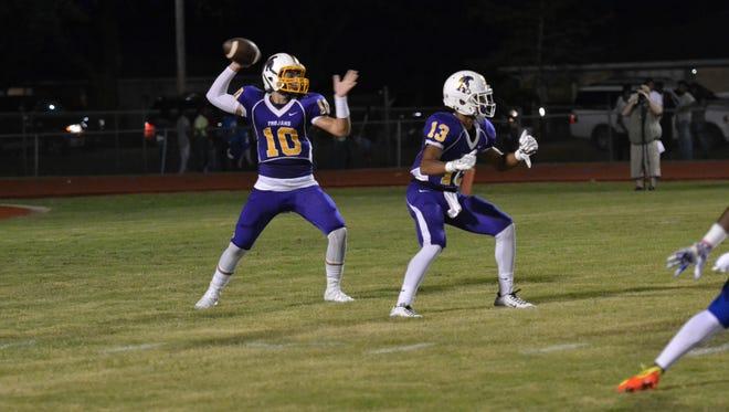 ASH sophomore quarterback Ben Hesni (10) drops back to pass during the Cenla Jamboree last season.