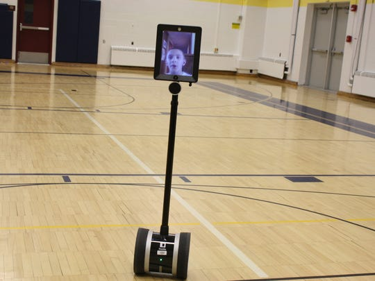 Tiernan Kriner, 8, is able to participate in class at Maine Memorial Elementary through a telepresence robot, an iPad and Chromebook.