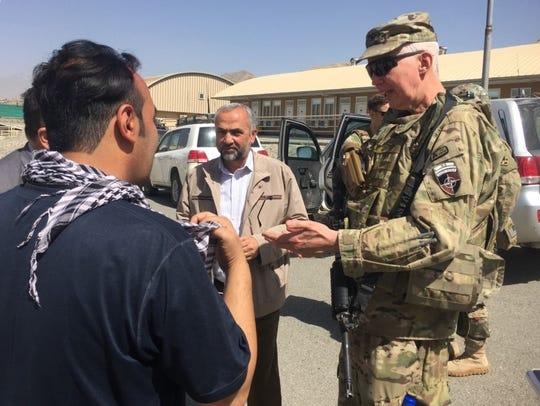 U.S. Army Col. Craig T. Trebilcock (right) and Afghan