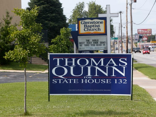 A Thomas Quinn campaign sign is placed in the yard