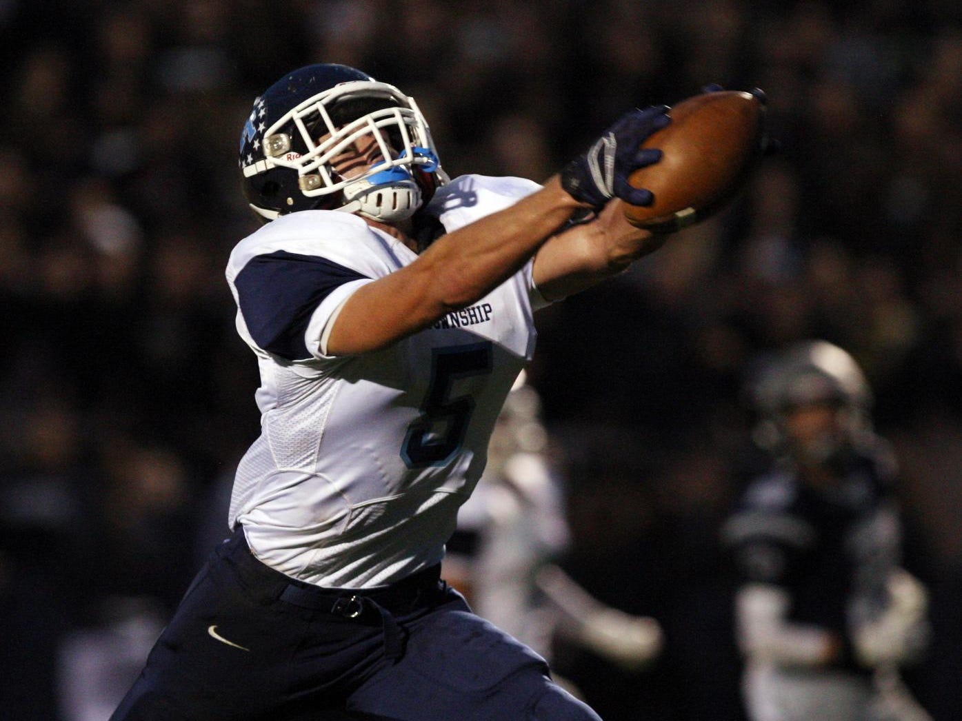Anthony Lotti, #5 Freehold Township, holds onto the ball to make the catch and score a touchdown against Howell in a football game Friday, September 25, 2015, at Howell High School.
