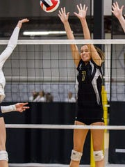 Oconomowoc sophomore Taylor Alden (7) blocks at the net during a match against West Bend West in the Mizuno Charger Rally at the Milwaukee Sting Center on Saturday, Sept. 16, 2017.