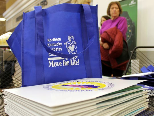 Packets of information prepared for a supermarket tour for those with diabetes at Independence Kroger.  Standing at the back is participant Linda Riddle of Independence.