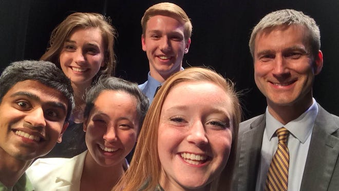 Selfie with the mayor:  Akash Borde, Allison Clements, Lilian Zhu, Connor Schueler, and Anna Schuchert (left to right) with Iowa City mayor Matt Hayek at the Youth Human Rights award ceremony at the Englert 5/14.
