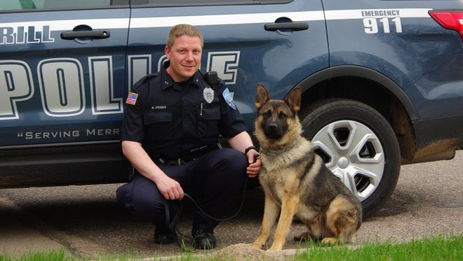 Enos and his handler Officer Matt Drabek with the Merrill Police K-9 unit.