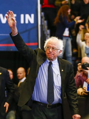 Bernie Sanders waves as he arrives to speak at a campaign event at Carthage College in Kenosha, Wis., on March 30, 2016.