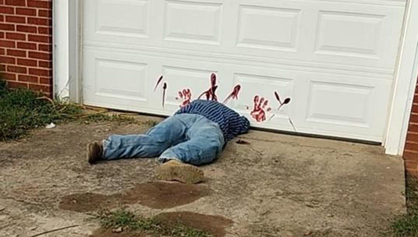 Police stop calling 911 this is a halloween decoration for Garage man door