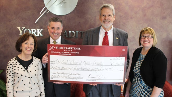 Pictured with Bob Woods, executive director for United Way of York County (second from right) are York Traditions Bank representatives (left to right) Carolyn Schaefer, managing director of specialized banking, Gene Draganosky, president & CEO, and Melissa Moore, personal banking delivery specialist and coordinator of the donations.
