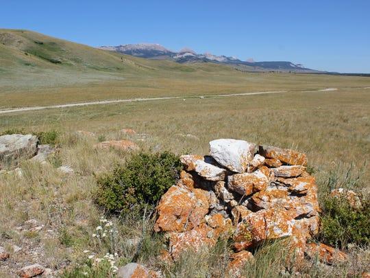 A well-preserved cairn along a historic buffalo run near Pine Butte.