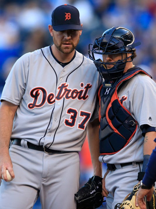 Detroit Tigers starting pitcher Mike Pelfrey (37) and catcher Jarrod Saltalamacchia, right, meet on the mound with bases loaded with Kansas City Royals during the first inning of a baseball game at Kauffman Stadium in Kansas City, Mo., Thursday, April 21, 2016. (AP Photo/Orlin Wagner)