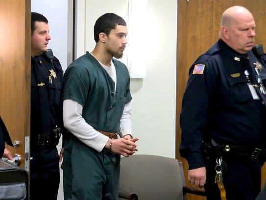 Andreas Erazo arrives in Judge David F. Bauman's courtroom