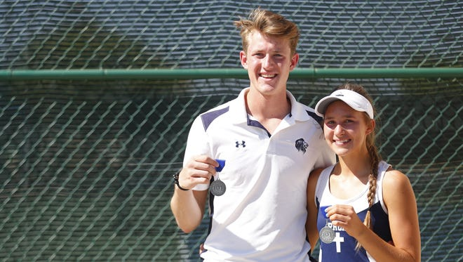 Pusch Ridge's Sofia Fetsis (R) and Preston Grammond hold their first place awards after winning the Girl's and Boy's State Tennis Singles Finals at Paseo Racquet Center in Glendale, Ariz. on April 28, 2018.