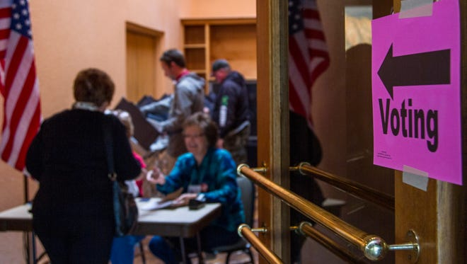 A group of people vote for the Cedar City election at The Crystal Inn, Tuesday, Nov. 3, 2015.