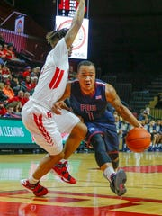 Dec 23, 2015; Piscataway, NJ, USA;  Fairleigh Dickinson Knights guard Stephan Jiggetts (1) drives to the basket during the first half against Rutgers Scarlet Knights guard Corey Sanders (3) at the Louis Brown Athletic Center. Mandatory Credit: Jim O'Connor-USA TODAY Sports
