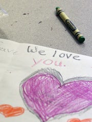 Linden Police Officer Angel Padilla who was shot Monday by alleged bombing suspect Ahmad Khan Rahami on Monday as he visits with Linden School # 5 school children who are making him get well cards on Thursday September 22, 2016.Thank You cards are made by students as they wait the arrival of Officer Padilla.